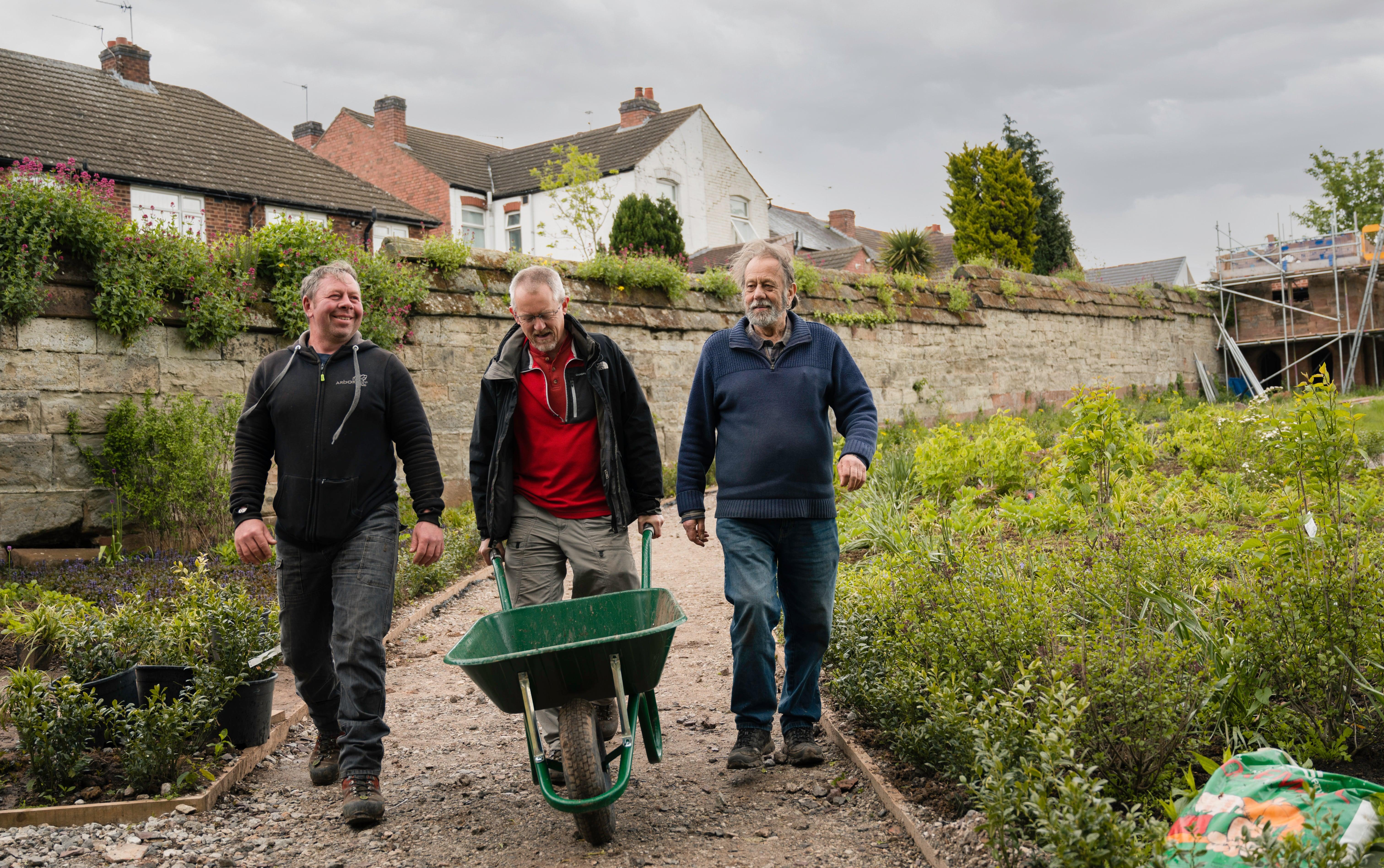 Volunteers with wheelbarrow at Charterhouse